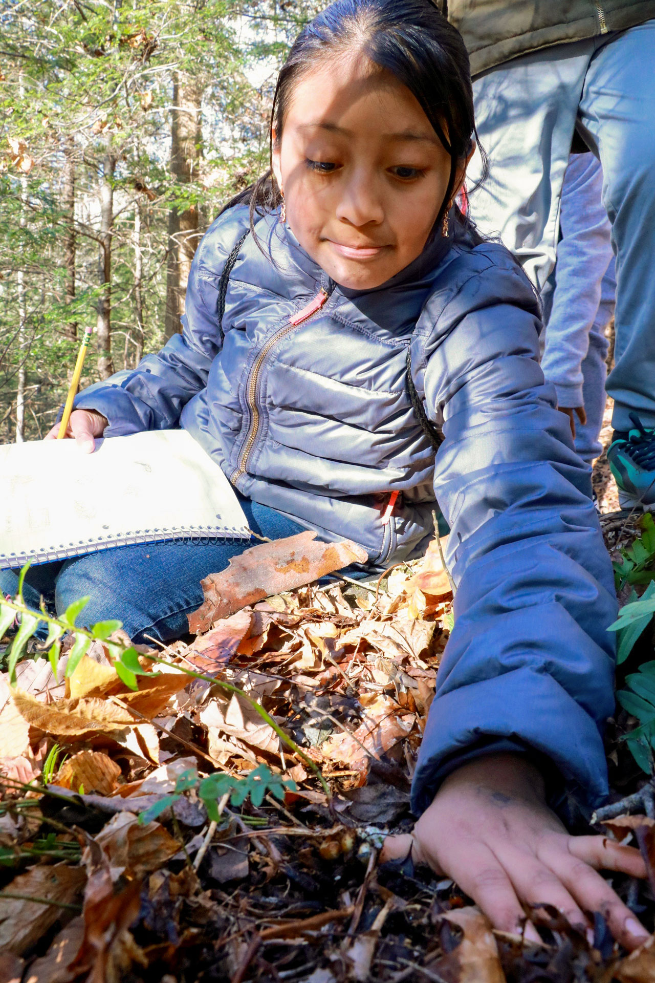 A young student explores Great Smoky Mountains National Park during Tremont Institute's Level Up Challenge