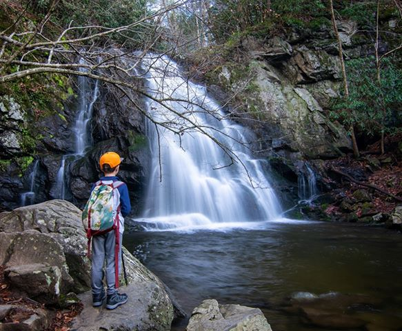 Wes Bunch's seven-year-old son takes in Spruce Flats Falls
