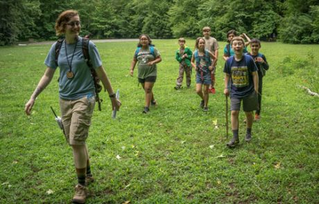 Campers walk across Dorsey Field on Tremont's campus. Photo by David Bryant.