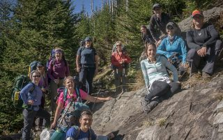 A group of women backpackers pause along a mountainside in Great Smoky Mountains National Park