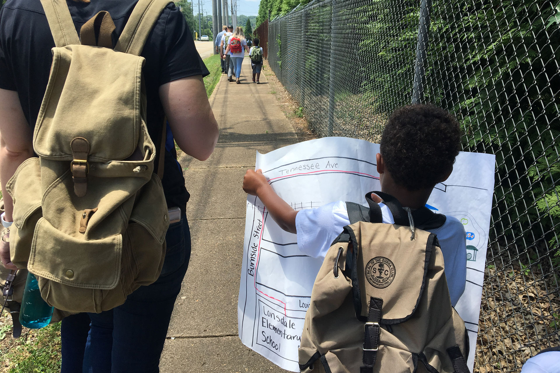 A student uses a map to navigate the neighborhood near school