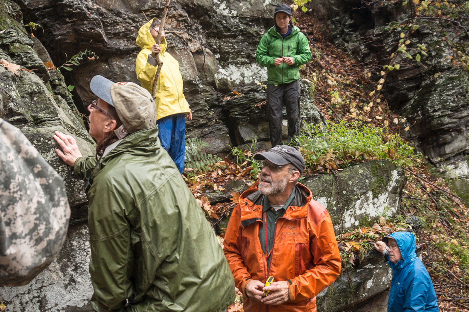 Geology workshop participants study a rock formation in the Smoky Mountains