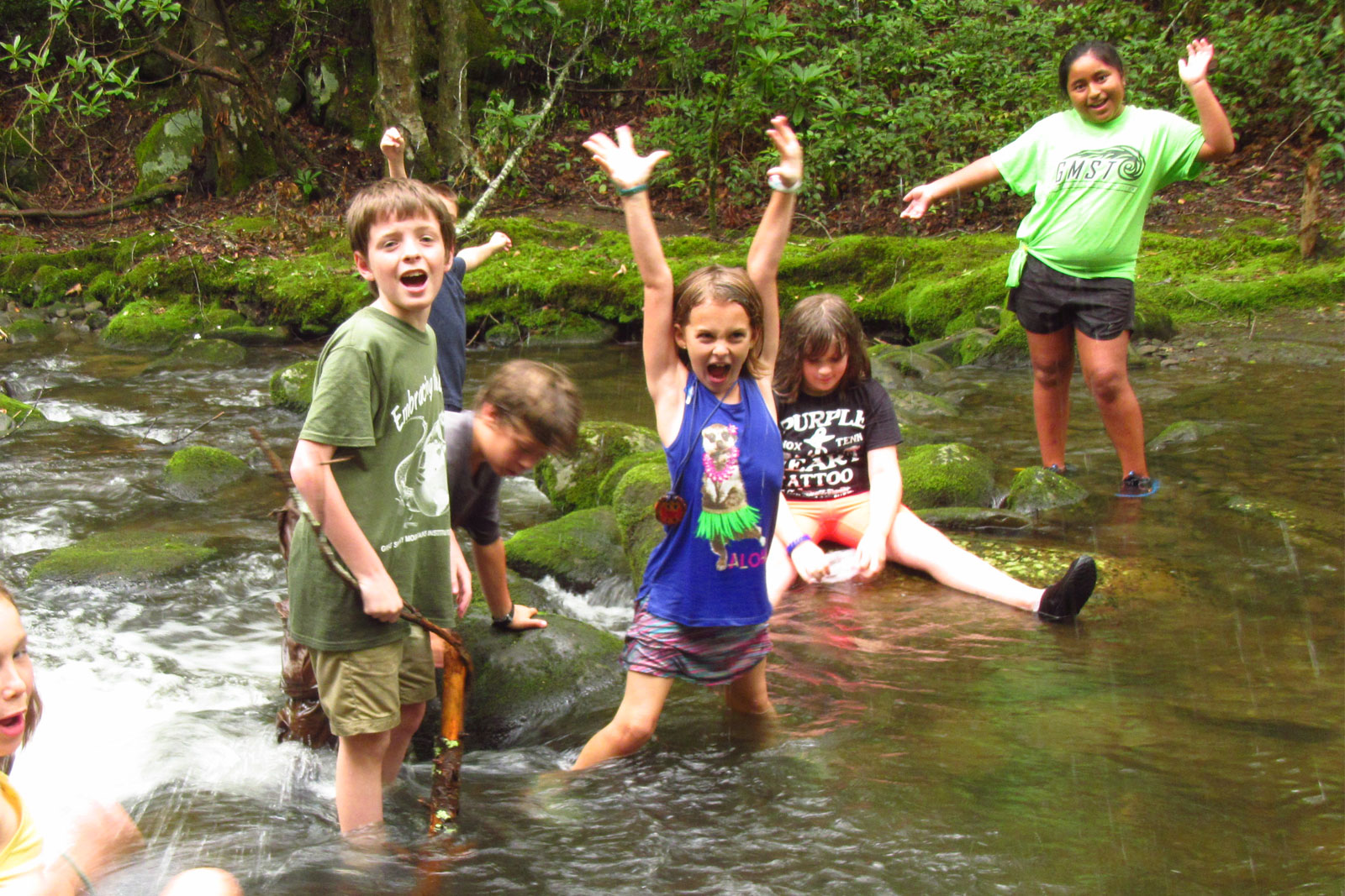 Discovery campers play in the stream