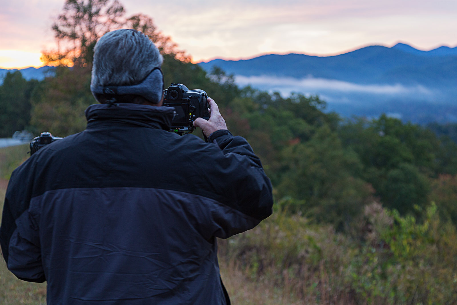 A workshop participant takes photos of the Smoky Mountains