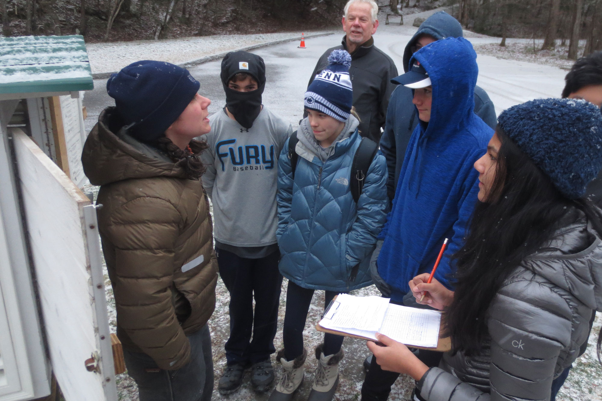 Middle school students use the weather station to check the weather in the morning
