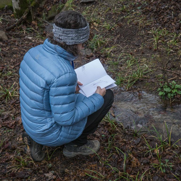 A Naturalist Skills Certification program participant studies wood frog eggs