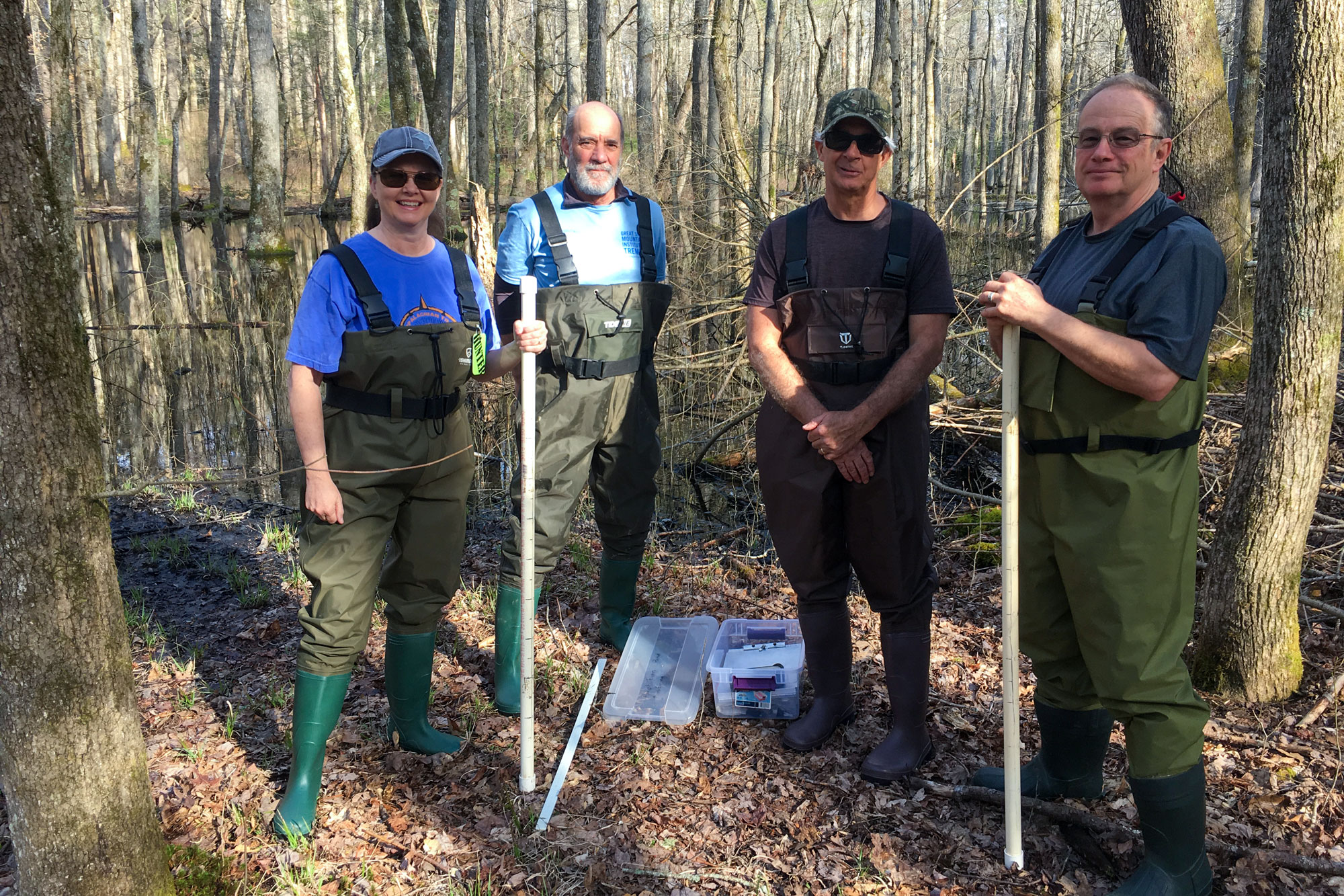 Community science volunteers pose for a photo after monitoring vernal ponds for vernal pond breeding amphibians in the Smokies
